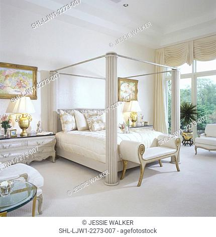 MASTER BEDROOM - Elegant, modern. Four poster bed. Beige tones through out, wall to wall carpeting, large windows, elaborate swag drapes