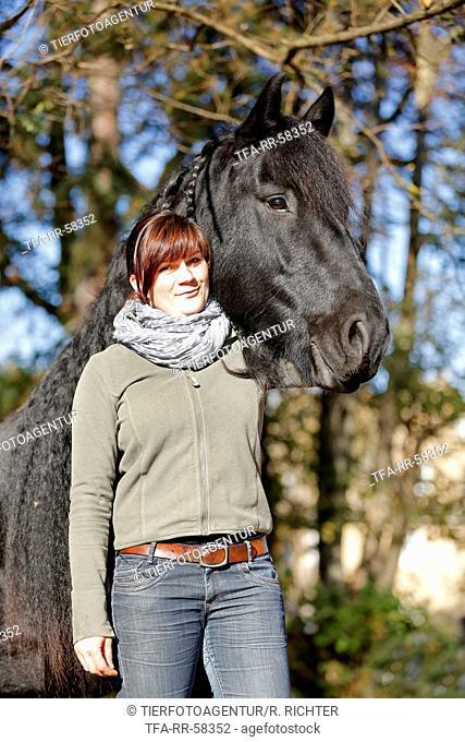 woman and Frisian horse