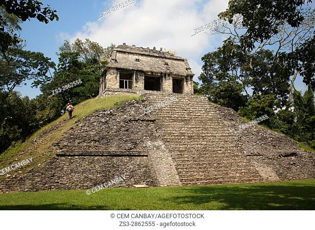 Man standing near the Temple of Conde-Templo del Conde in Palenque Archaeological Site, Palenque, Chiapas State, Mexico, Central America