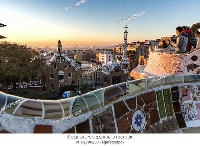 Park Guell with city skyline behind at sunrise, Barcelona, Catalonia, Spain