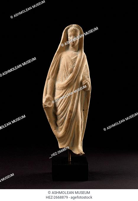 Terracotta statuette of a pious Roman veiling his head with his toga, 1st century. Artist: Unknown