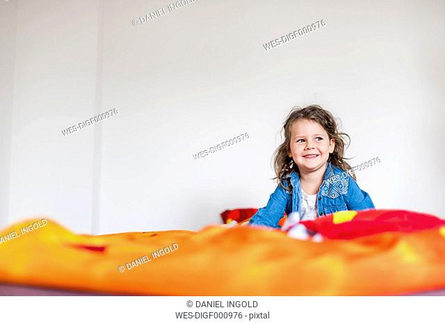 Smiling girl on bed
