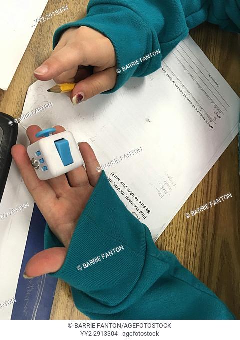 6th Grade Girl Using Fidget Spinner, Wellsville, New York, USA