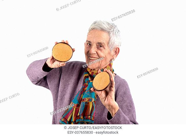 senior woman eating cookie. on white background