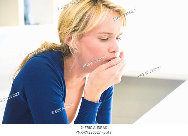 Close-up of a woman coughing
