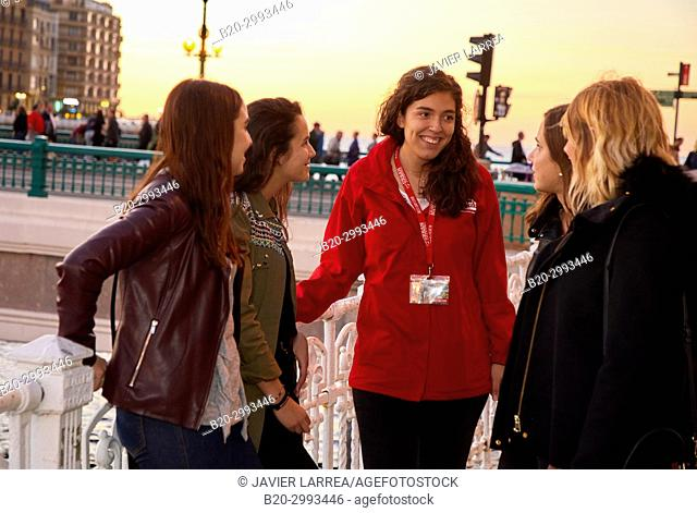 Group of tourists and guide making a tour of the city, La Zurriola bridge, Urumea river, Donostia, San Sebastian, Gipuzkoa, Basque Country, Spain, Europe
