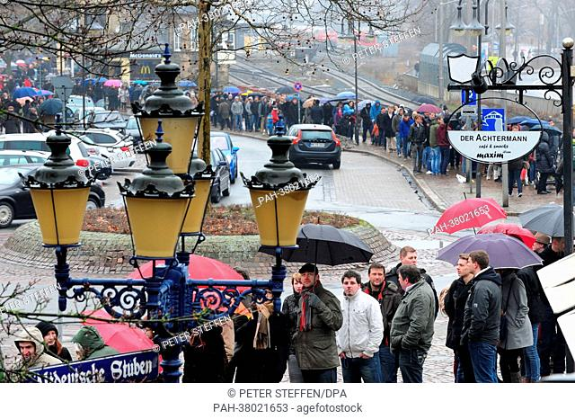 Extras wait in a queue for their casting for a film by George Clooney in Goslar, Germany, 09 March 2013. Around 2,000 extras will be cast for the movie 'The...