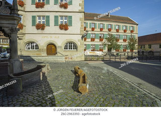medieval well and guildhall of the Renaissance in the village Boersch, on the Wine Route of Alsace, France
