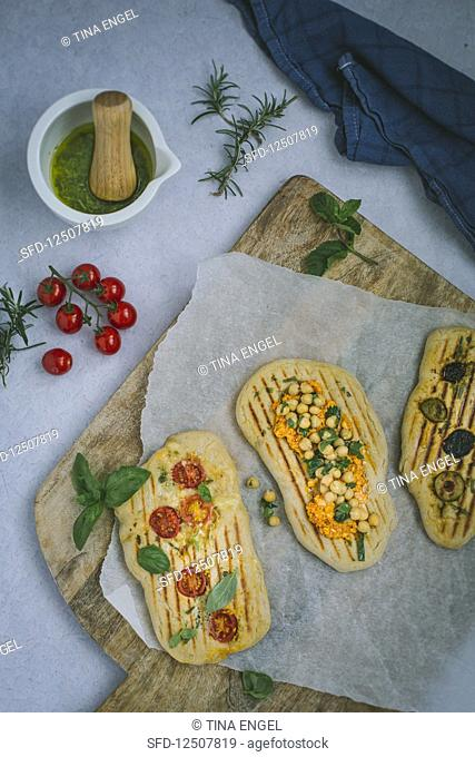 Grilled bread with various spicy toppings
