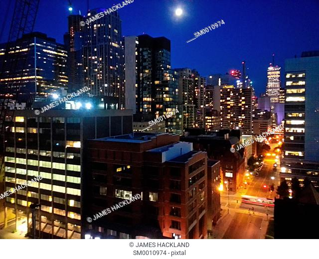 Night shot with a full moon of Toronto's downtown core. Toronto, Ontario, Canada
