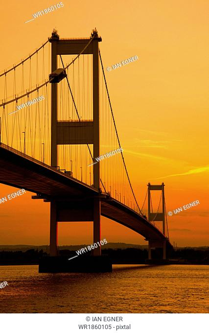 Severn Bridge viewed from the River Severn at sunset, Gloucestershire, England, United Kingdom, Europe