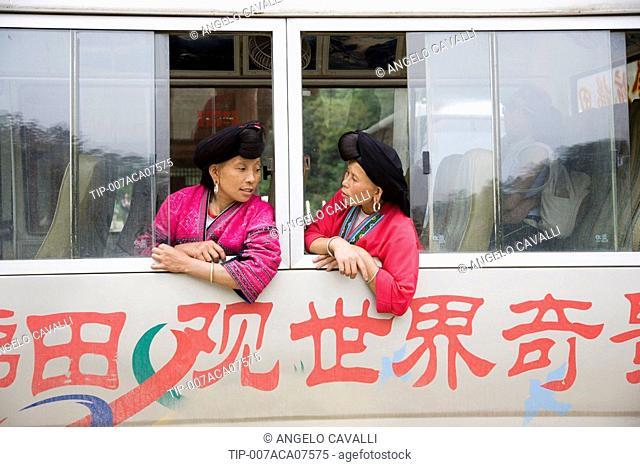 China. Guangxi Province. Guilin. Longsheng, Women of Yao mountain tribe on bus