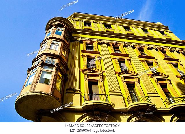 Old yellow apartment building. Gracia quarter, Barcelona, Catalonia, Spain