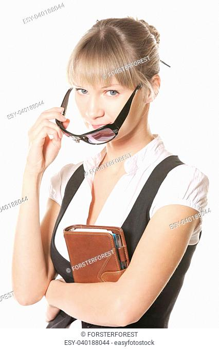 Caucasian woman with leather notebook looking over sunglasses