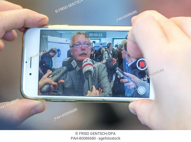 Ralf Oestermann, head of the homicide division, seen on a smartphone display as he speaks during a press conference in a police facility in Bielefeld, Germany