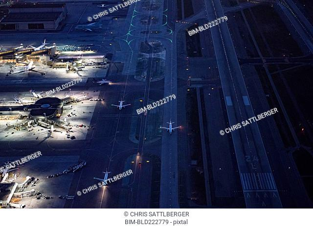Aerial view of airplanes taxing on airport runway