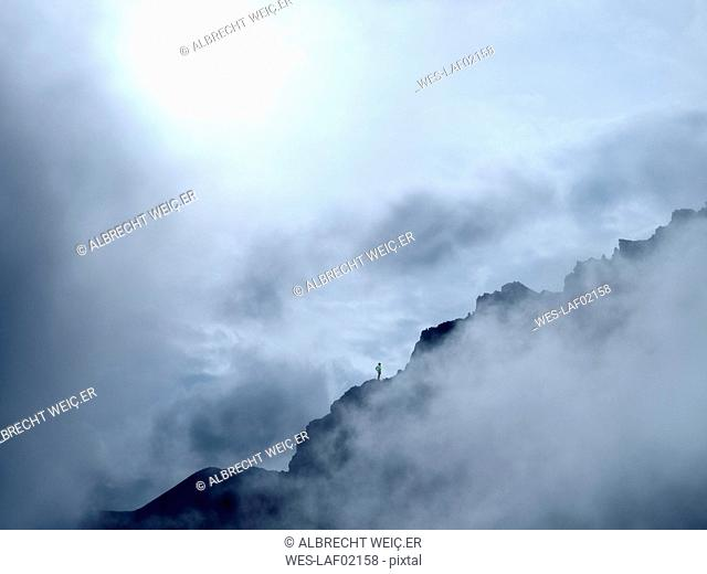 Border region Italy Switzerland, mountain landscape in clouds at Piz Umbrail