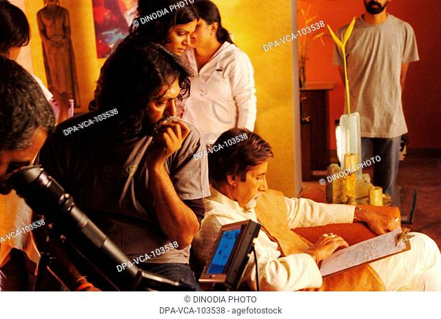 Director Rakesh Mehra shooting South Asian Indian Bollywood film star  Amitabh Bachchan for ad film in Mehboob studio ; Bombay Mumbai ; Maharashtra ; India