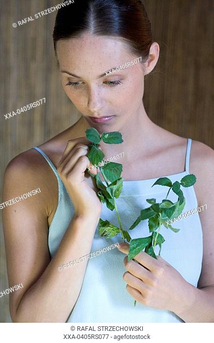 beauty woman with fresh herbs