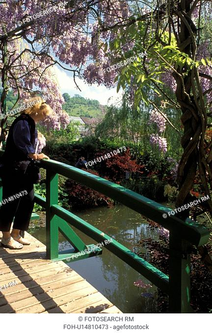 Giverny, France, Eure, Normandy, Paris, Europe, Japanese bridge crosses over the Lily Pond in the Jardin d'Eau at Claude Monet Country Home and Gardens in...
