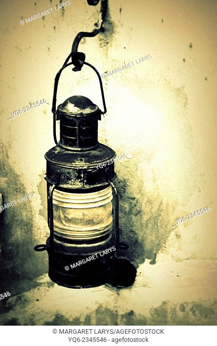 Front view of a rusty oil lantern
