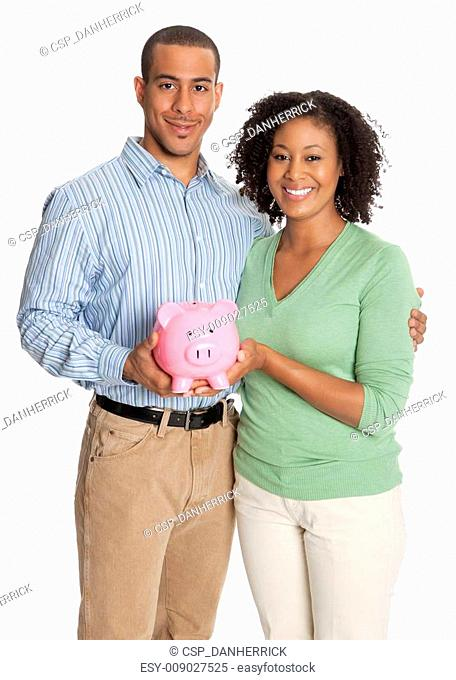 Happy portrait of a young couple with pink piggy bank
