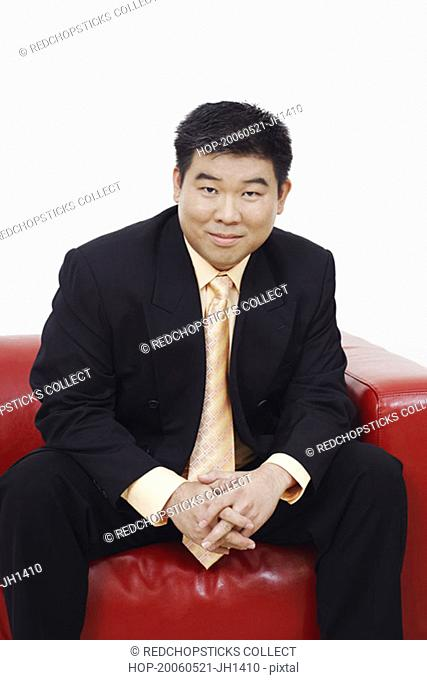 Portrait of a businessman sitting on a couch