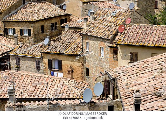 Old roofs with satellite dish, Volterra, Tuscany, Italy