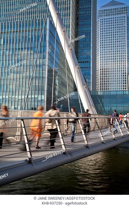 Commuters crossing footbridge, Canary Wharf, London, England, UK