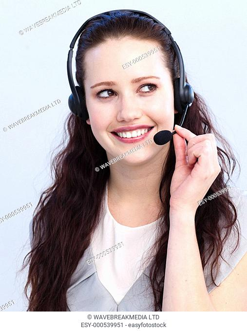 Smiling brunette woman working in a call center