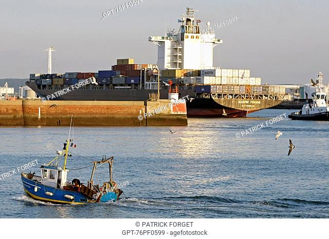 TRAWLER ENTERING THE PORT IN FRONT OF A CONTAINER SHIP, COMMERCIAL PORT, LE HAVRE, SEINE-MARITIME 76, NORMANDY, FRANCE