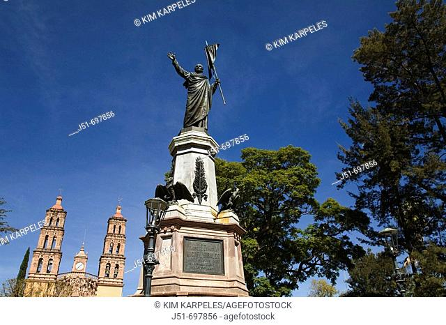Miguel Hidalgo monument in plaza, honor Father of Mexican Independence, city where cry of freedom made, twin church towers  Dolores Hidalgo, Mexico