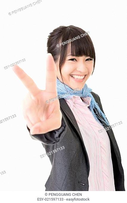 Asian business woman showing a gesture of peace