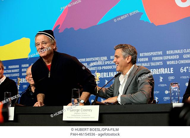 Actor Bill Murray (L) and actor/director George Clooney attend the press conference of 'The Monuments Men'during the 64th annual Berlin Film Festival, in Berlin