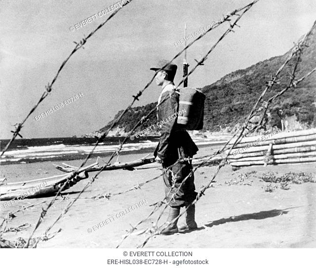 Chinese Nationalist soldier stands guard on a sandy beach somewhere along Formosa's coast. Nationalists and mainland Communists engaged to occasional clashes in...