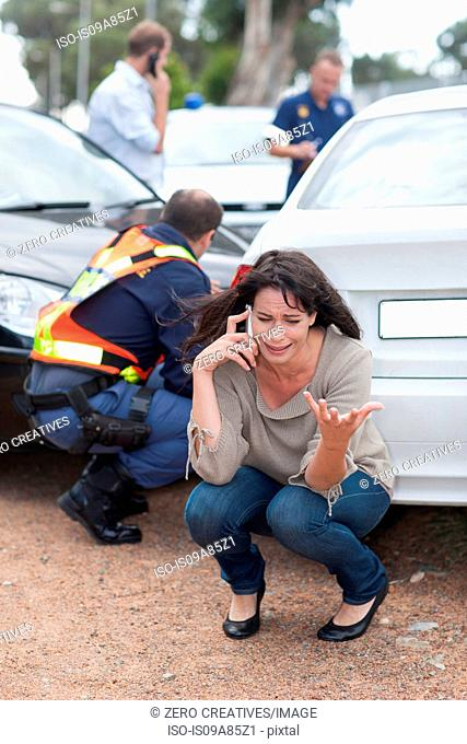 Woman crying after car accident