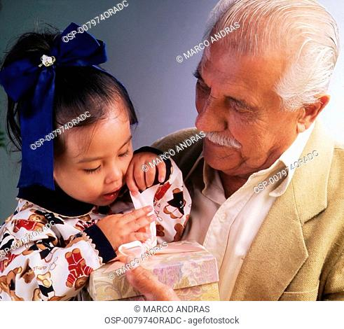 grandfather holding young girl