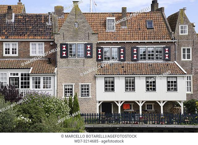 Enkhuizen, small city of northern holland, historic buildings with many windows and flowers