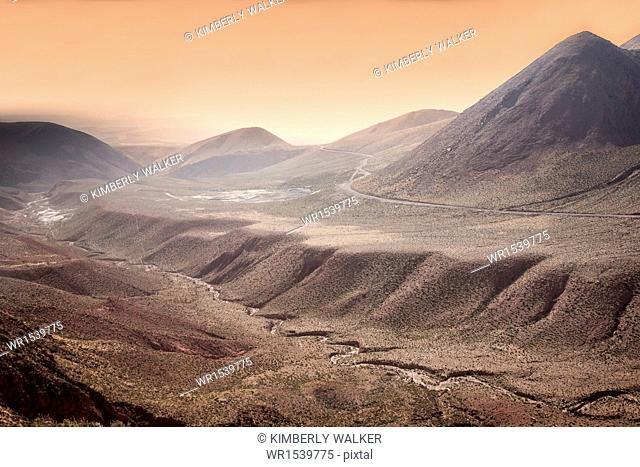 High altitude Atacama desert landscape near Tatio Geyser Field at sunset, Chile, South America