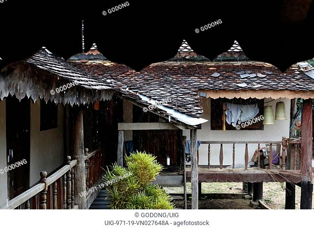 Bahnar (Ba Na) ethnic group traditional house under heavy monsoon rain. Kon Tum. Vietnam
