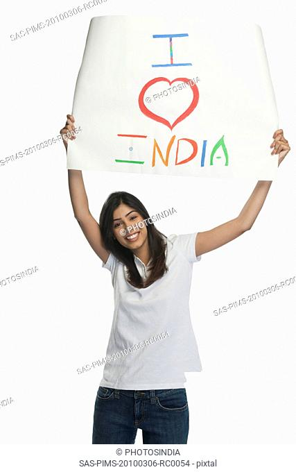 Woman holding a placard with text I Love India written on it
