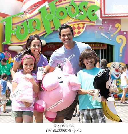 Hispanic family enjoying amusement park