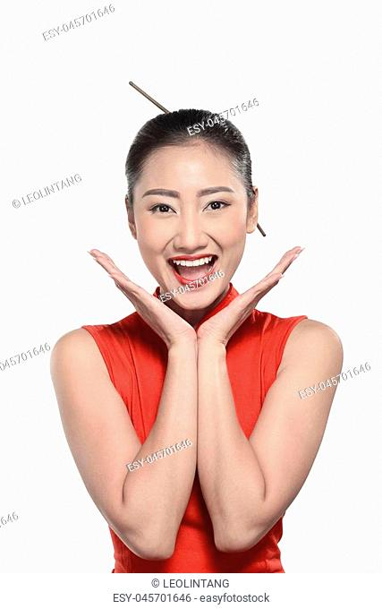 Chinese girl in cheongsam dress. Happy chinese new year concept