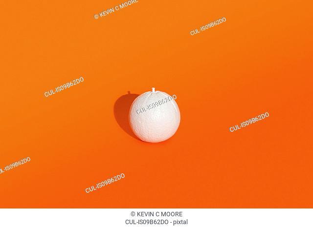 Orange painted white on orange background