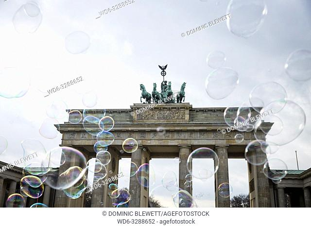 Soap bubbles blowing in front of the Brandenburg Gate in Berlin, Germany