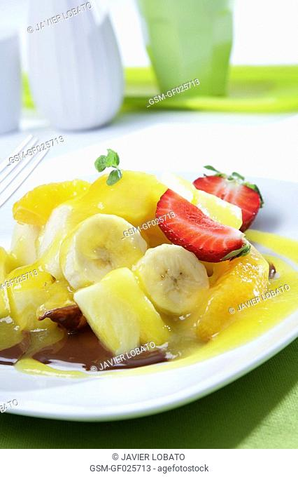 Seasonal fruits with mango juice and hot chocolate sauce