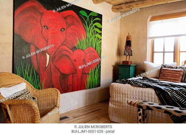 Large painting of an elephant in artist's bedroom