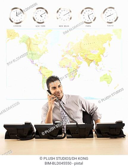 Indian businessman talking on telephone