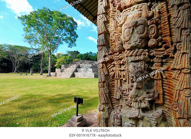 One of the temples in the Copan Ruinas and Stela H in the front