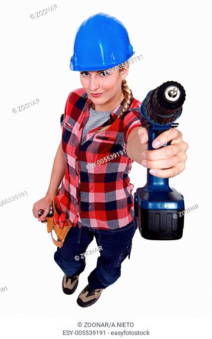 A female handyman with a drill